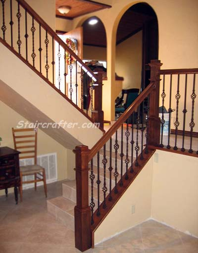 Staircase with pony wall removed, adding decorative iron
