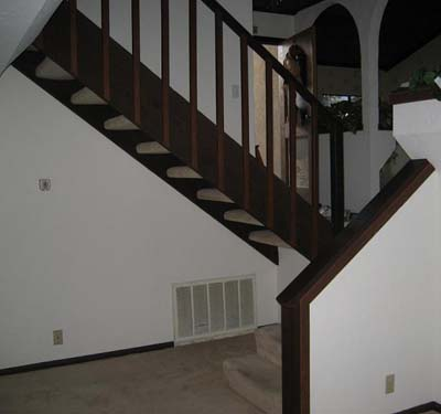 Staircase with pony wall and open bottom stairs